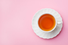 Tea In White Cup On Pink Background. Copy Space. Top View.