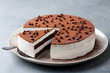 Leinwandbild Motiv Tiramisu cake with chocolate decotaion on a plate. Grey background. Close up.