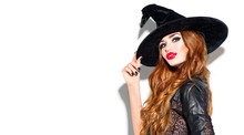Halloween Sexy Girl Wearing Witch Costume With A Hat. Party, Celebrating. Beauty Woman With Long Hair And Holiday Bright Make-up Isolated On White Background.