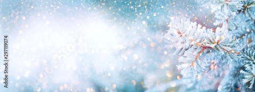 Poster Countryside Christmas winter blurred background. Xmas tree with snow decorated with garland lights, holiday festive background. Widescreen backdrop. New year Winter art design, wide screen holiday border