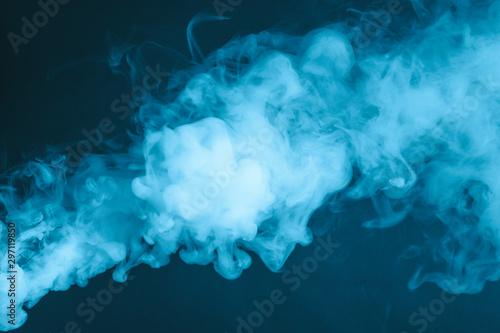 Cuadros en Lienzo  Cloud of vapor. Dark blue background