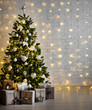 Leinwanddruck Bild decorated christmas tree with white balls, garlands and gift boxes over white brick wall