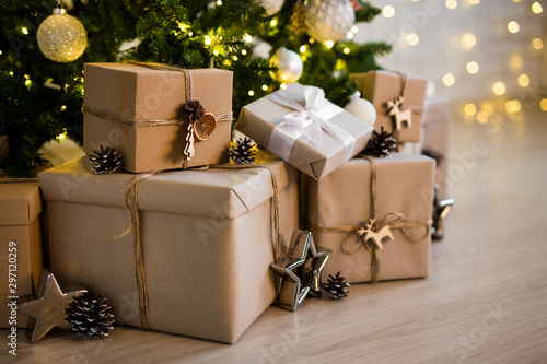 Foto op Canvas Bomen close up of beige gift boxes near decorated christmas tree
