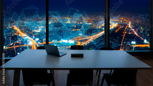 Vászonkép  Meeting room and Workplace with notebook laptop Comfortable work table in office windows and Bangkok city view with network concept