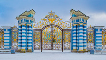 Saint Petersburg. Leningrad Region. Town Of Pushkin. Tsarskoe Selo. Golden Gate In Pushkin. The Front Gate Of The Catherine Palace. Gate With Striped Pillars And Tracery Bars.Architectural Masterpiece