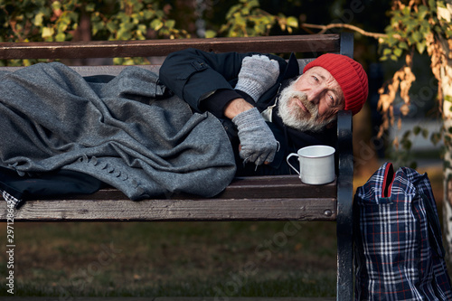 Roofless male lying on street bench asking for money, for any help Tablou Canvas