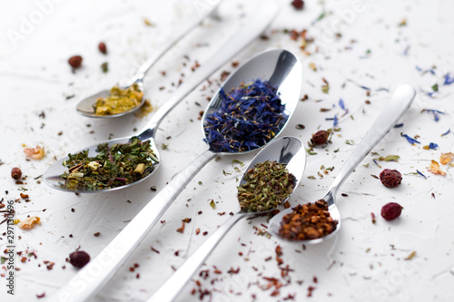 Flat lay leaves of red, fruit, herbal tea with spices. - 297130696