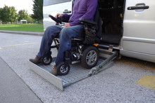Disabled Men On Wheelchair Usi...