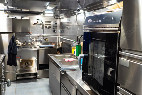Industrial kitchen. Room for cooking for employees of the enterprise. Kitchen equipment. Chef's workplace. The compact kitchen.