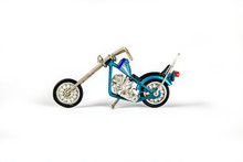 Photo Of A Toy Motorcycle On A White Seamless Background. 4
