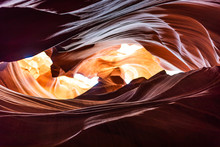 Low Angle View Of Dark Red Shadows And Light Sky At Upper Antelope Slot Canyon With Wave Shape Rock Sandstone In Page, Arizona