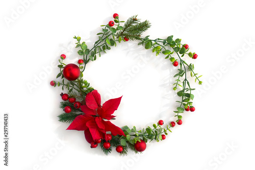 Obraz Christmas decoration. Frame of flower of red poinsettia, branch christmas tree, christmas ball, red berry on a white background with space for text. Top view, flat lay - fototapety do salonu