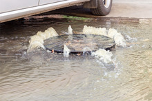 Accident Sewerage System. Water Flows Over The Road From The Sewer. Water Flows Over The Road From The Sewer. The Accident In The Sewer.