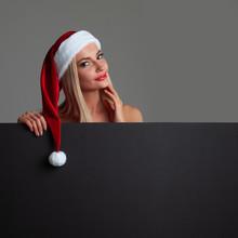 Santa Girl Holding Blank Billb...