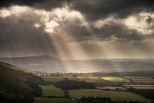 Stunning Summer Landscape Image Of Escarpment With Dramatic Storm Clouds And Sun Beams Streaming Down