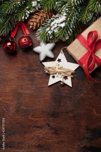 Christmas greeting card with gift box, decor and fir tree