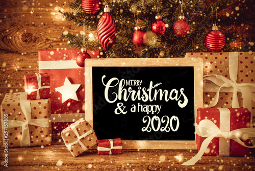 Papiers peints Kiev Blackboard With English Text Merry Christmas And A Happy 2020. Christmas Tree With Decoration Like Ball, Gifts And Presents, Snowflakes