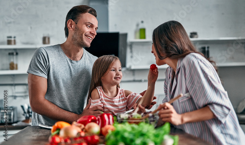 Family in kitchen Poster Mural XXL