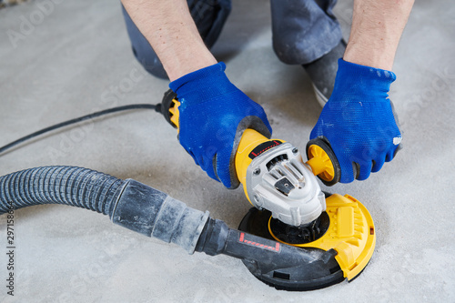 Photographie concrete floor surface grinding by angle grinder machine
