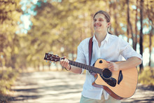 A Man With A Guitar On Summer Day Outdoors