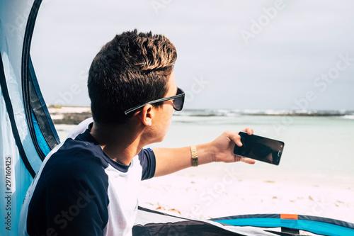 Young caucasian people handsome boy viewed from back taking picture with modern Billede på lærred