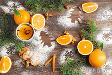 Christmas Composition With Fresh Oranges And Tea On Wooden Background