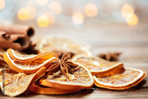 Fototapeta christmas decoration with anise and cinnamon on wooden background obraz