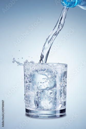 Stampa su Tela  pouring water into glass