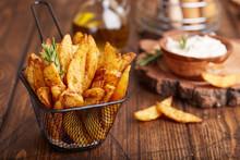 Potato Wedges Baked With Rosem...