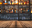 .Bar with blurred lights bokeh and wooden table