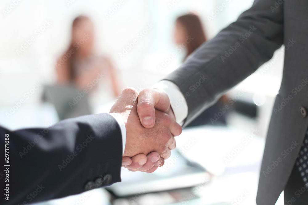 Fototapeta reliable handshake of business partners in the office