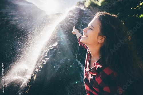 Fotografija  Young happy girl enjoing the waterfall