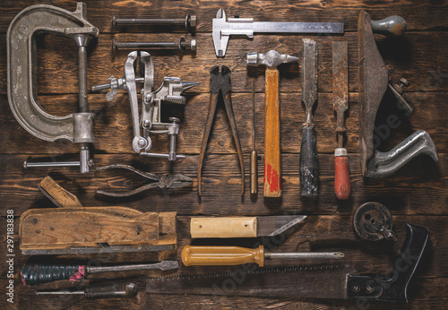 Obraz Old carpentry work tools on a brown wooden table background. - fototapety do salonu
