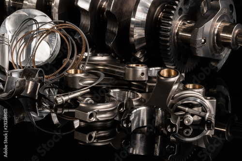 high performance racing motorcycle engine parts on a black reflective background Wallpaper Mural