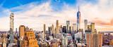 Fototapeta Nowy Jork - Aerial panorama of Lower Manhattan skyline at sunset viewed from above Greenwich street in Tribeca neighborhood.