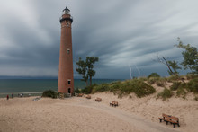 Lighthouse On The Beach With Lightning
