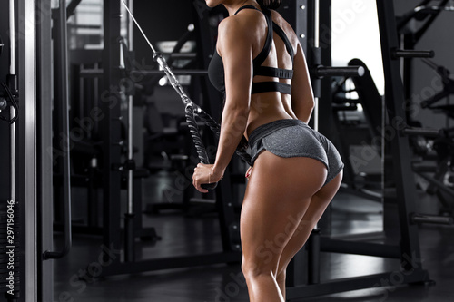 Fitness woman workout in gym Fototapeta
