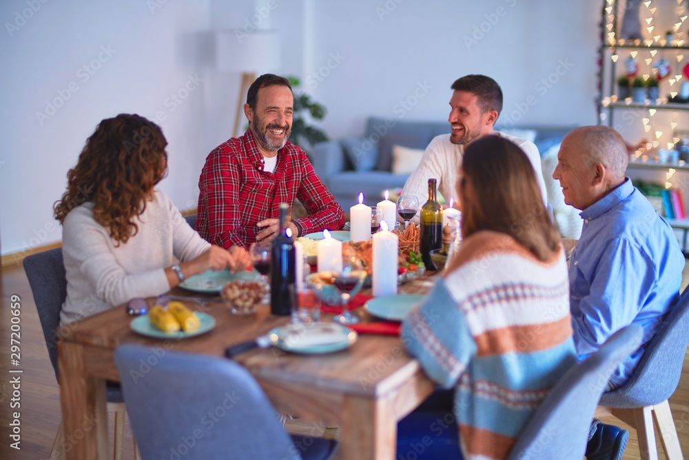 Fototapety, obrazy: Beautiful family smiling happy and confident. Eating roasted turkey celebrating Christmas at home