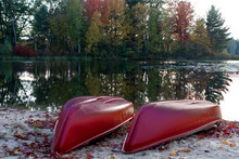 Red Kayaks Next To The Lake In The Fall