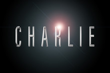 First Name Charlie In Chrome On Dark Background With Flashes