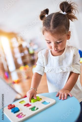 Obraz Young beautiful toddler learning mathematics playing with maths game at kindergaten - fototapety do salonu
