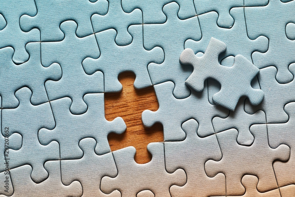 Fototapeta Jigsaw puzzle background, one last piece missing only, easy task