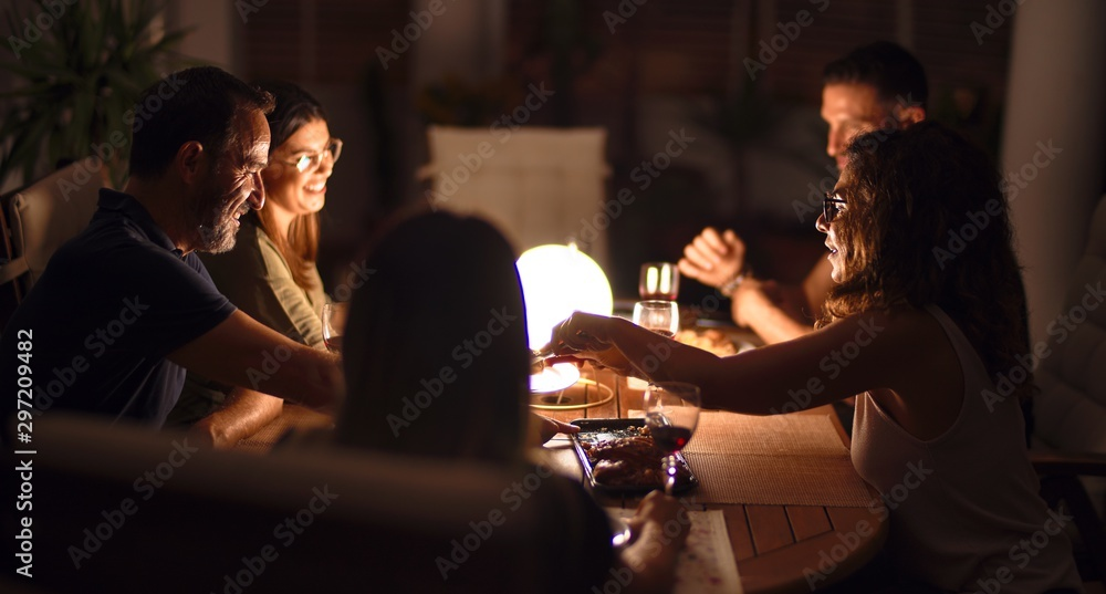 Fototapety, obrazy: Beautiful family on dinner talking and smiling at terrace