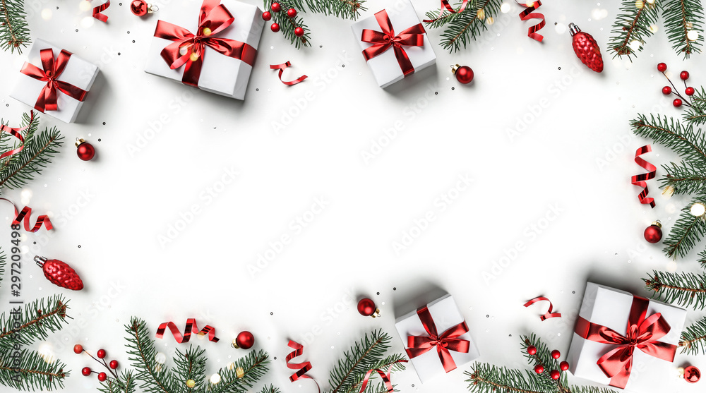 Fototapety, obrazy: Creative frame made of Christmas fir branches, gift boxes, red decoration, sparkles and confetti on white background. Xmas and New Year holiday, bokeh, light. Flat lay, top view