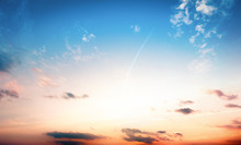 Natural Background Concept: Beautiful Blue Sunset Sky With White Clouds Background