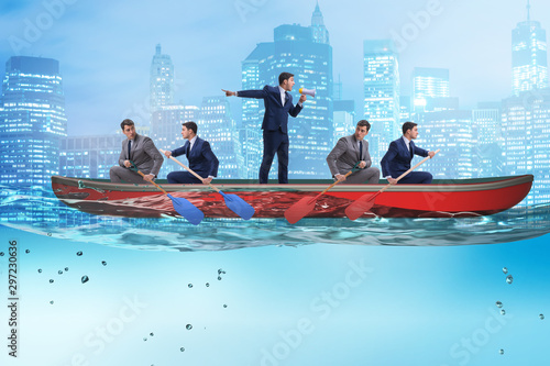 Fotografie, Obraz Disagreement concept with businessmen rowing in different direct