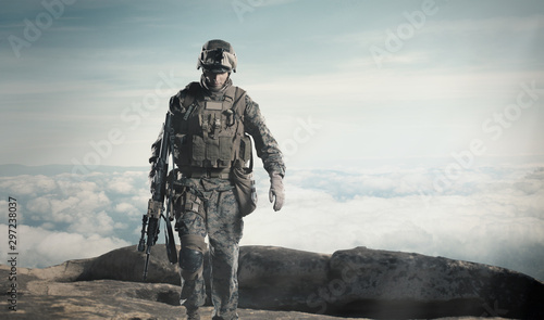 Soldier with a rifle. Steps against clouds. Canvas Print