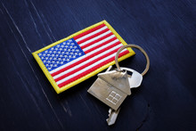 American Flag And Key From Home. VA Streamline Refinance Loan Concept.