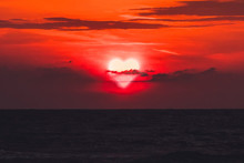 Heart Walks Off Into The Sunset Over The Sea In Dark Clouds. Past Love. Separation. Concept. Sun Is The Heart Is The Evening Before Sunset. Valentine's Day. Cloud Heart
