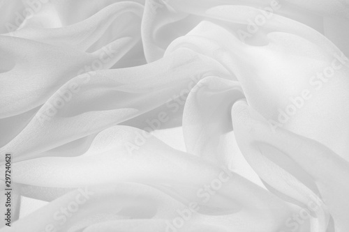 Photo Light draped chiffon fabric in light color for festive backgrounds